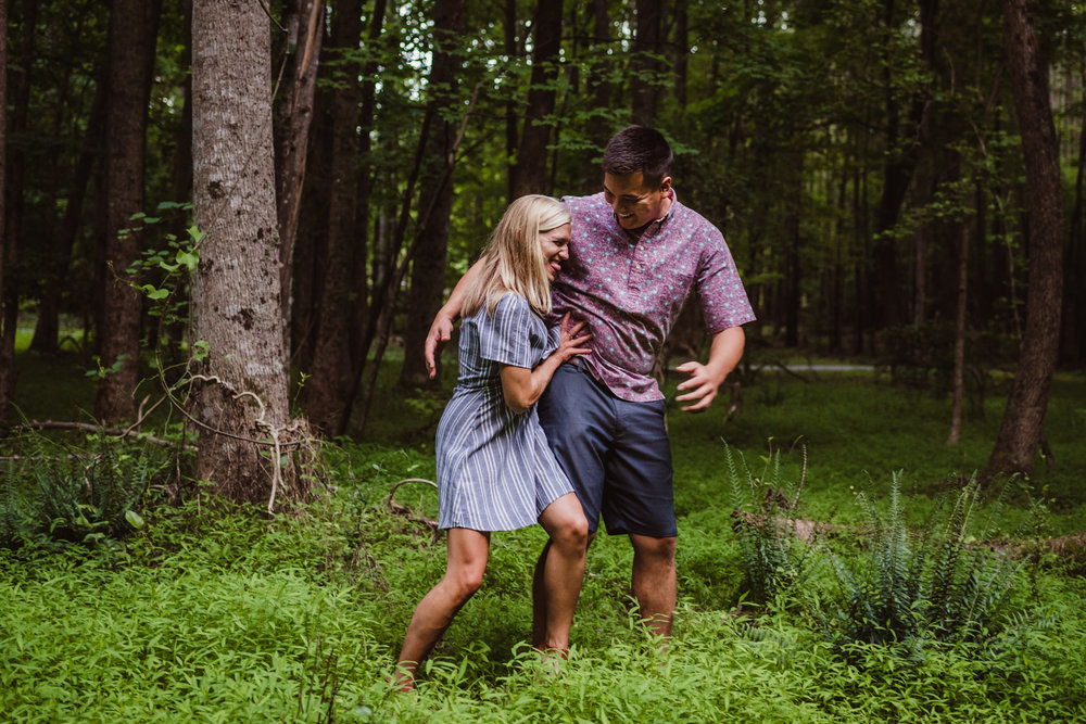 Kristin and Drew played in the woods during their engagement shoot in Raleigh with Rose Trail Images.