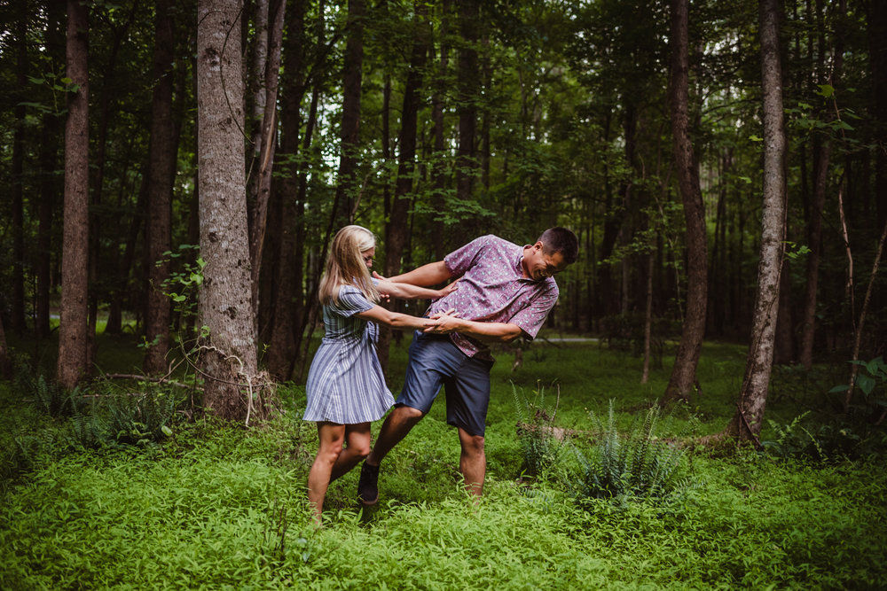 Kristin and Drew played together in the woods during their engagement shoot in Raleigh with Rose Trail Images.