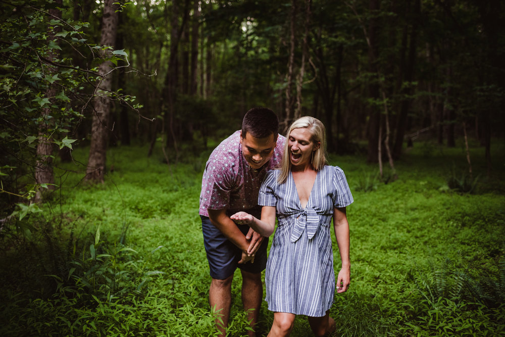 Kristin and Drew found a lightning bug in the woods during their engagement shoot in Raleigh with Rose Trail Images.