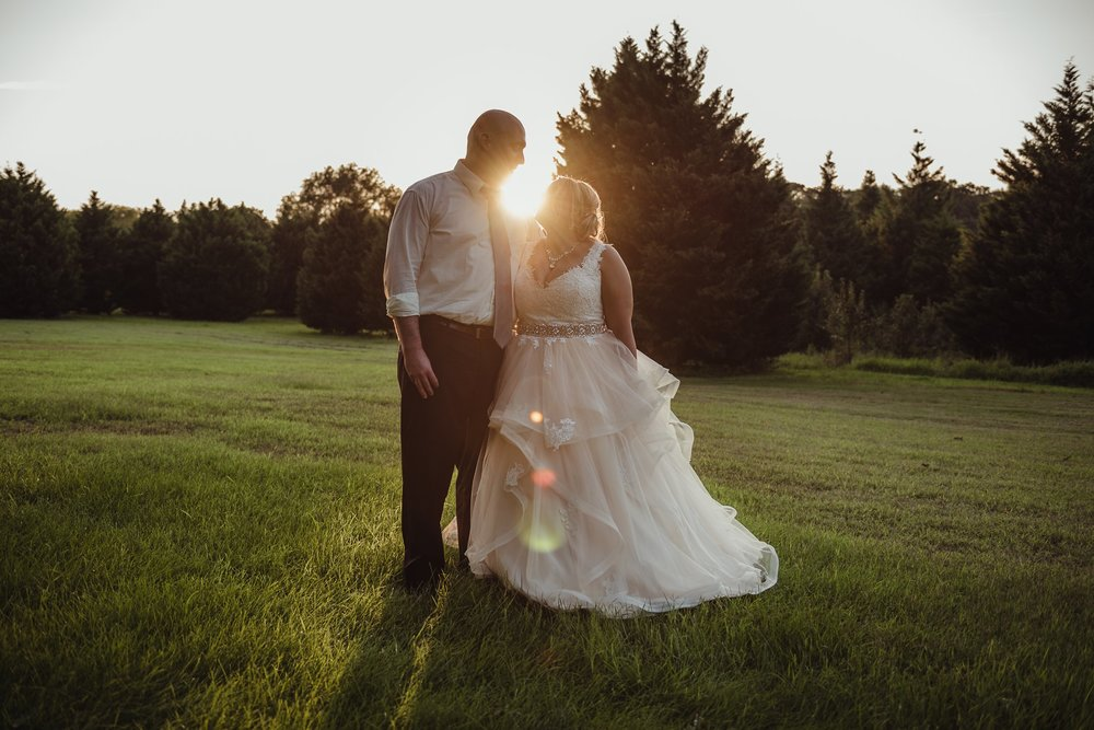 The bride and groom hold each other at sunset during their wedding day in Raleigh, photo by Rose Trail Images.