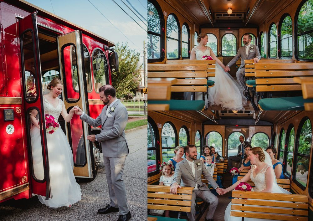 The bride and groom take pictures after the ceremony with the Raleigh Trolley in downtown Raleigh, NC, pictures by Rose Trail Images.