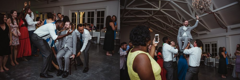 The groom got hoisted up on a chair during the wedding reception at the Merrimon Wynne in Raleigh, photos by Rose Trail Images.