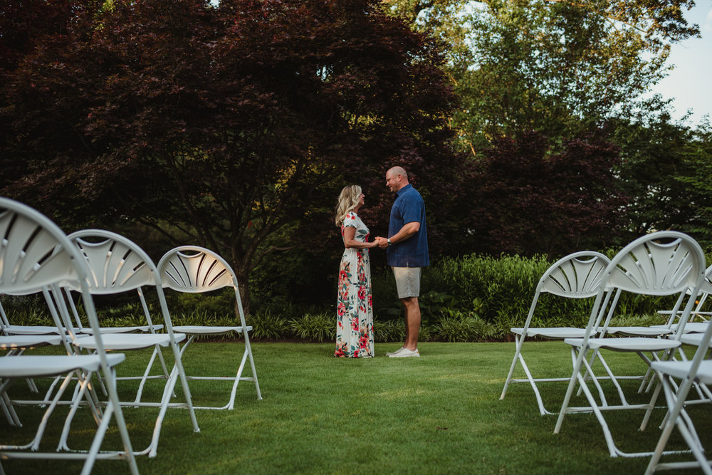 The groom and bride practice their big day during their engagement session at Fred Fletcher Park in Raleigh, North Carolina with Rose Trail Images.
