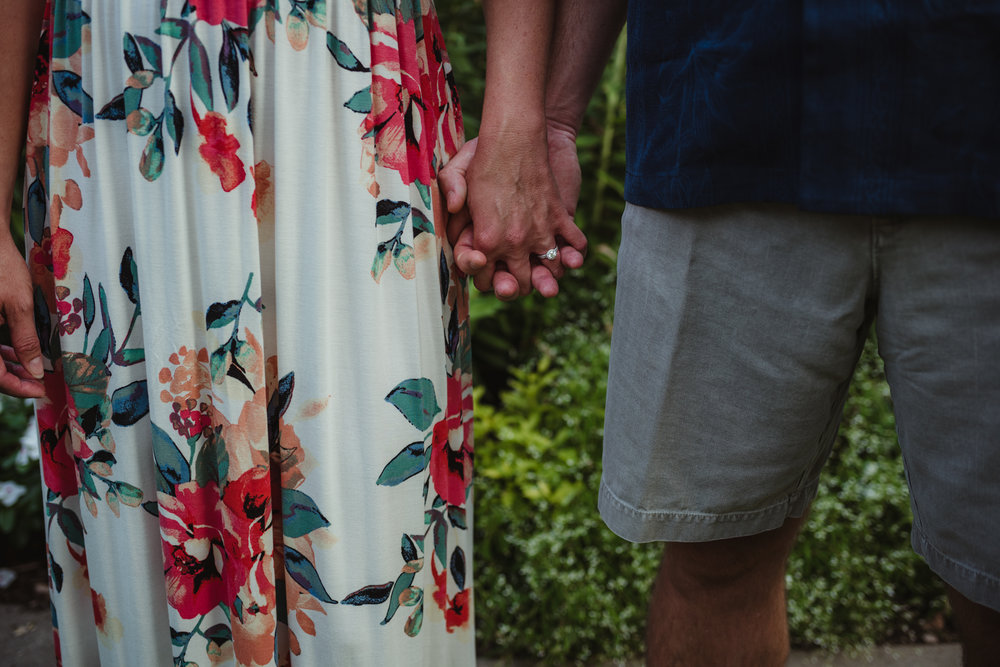 The bride and groom hold hands during their engagement session at Fred Fletcher Park in Raleigh, North Carolina with Rose Trail Images.