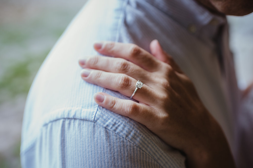A close up of the engagement ring during their Raleigh engagement session with Rose Trail Images.