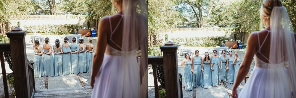 The bridesmaids have a first look with seeing the bride in her dress before her wedding in Wilmington, NC, photos by Rose Trail Images.