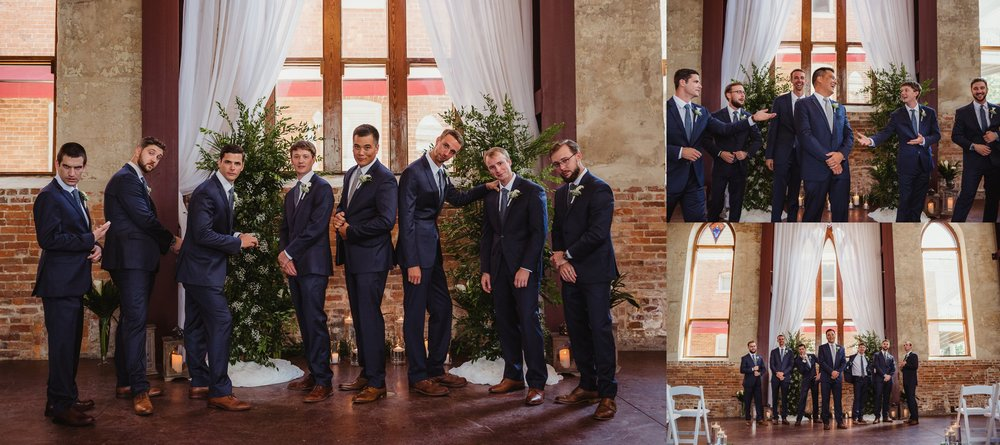 The groomsmen pose at the altar for pictures with Rose Trail Images before the wedding ceremony in Wilmington, North Carolina.