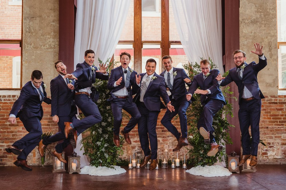 The groomsmen and the groom jump for joy before his wedding in Wilmington, NC, photo by Rose Trail Images.