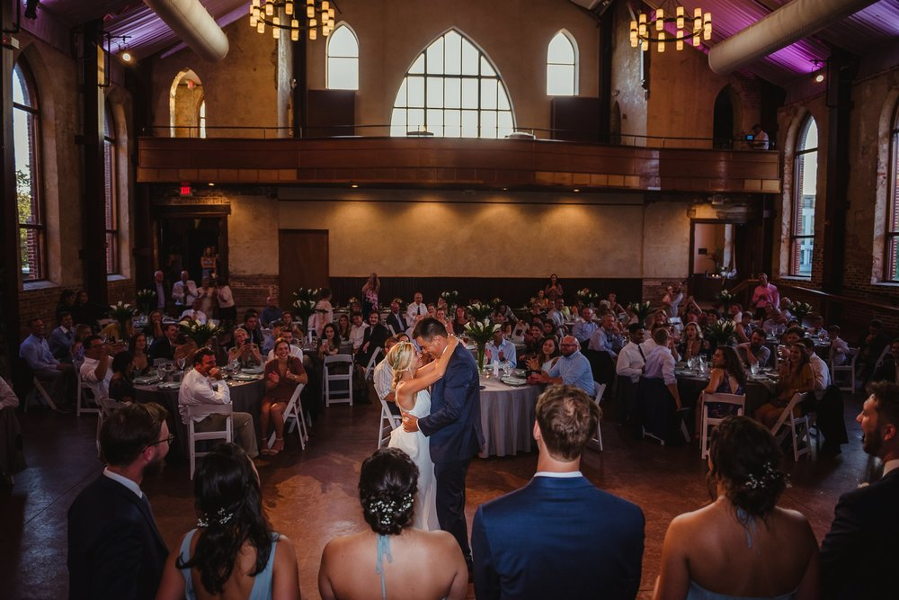 The bride and groom share a first dance at their wedding reception in Wilmington, NC, photo by Rose Trail Images.