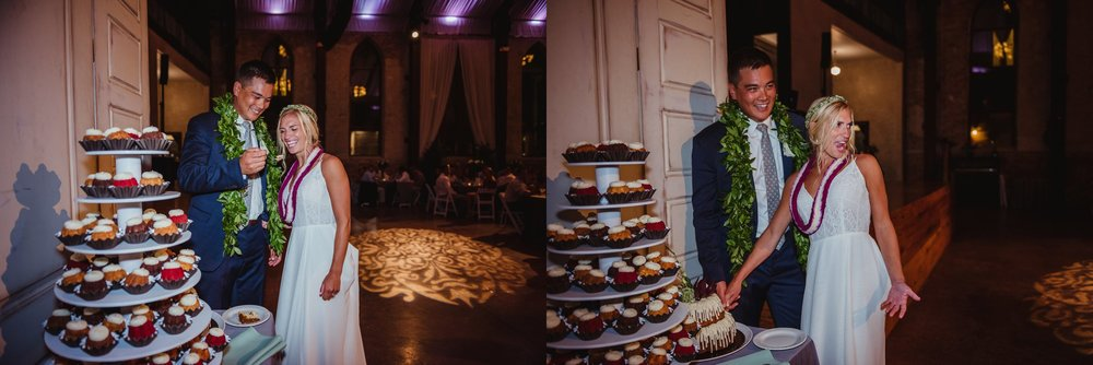 The bride and groom cut their wedding bundt cake at their wedding reception in Wilmington, NC, photos by Rose Trail Images.