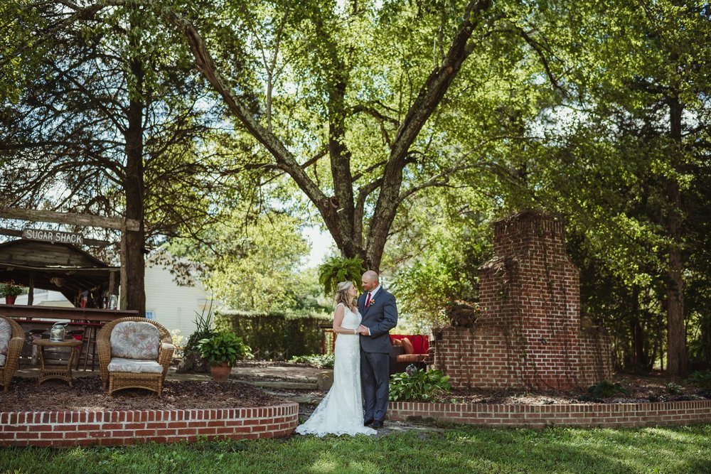 The bride and groom pose for portraits with Rose Trail Images after their wedding ceremony at Cedar Grove Acres near North Carolina.