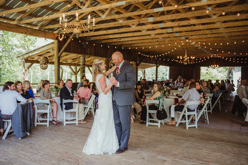 The bride and groom share their first dance during their wedding reception at Cedar Grove Acres near Raleigh, pictures by Rose Trail Images.