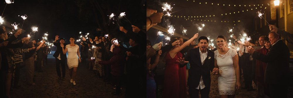 The bride and groom exited with a sparkler exit aft their wedding reception at Market Hall in downtown Raleigh, photos by Rose Trail Images.