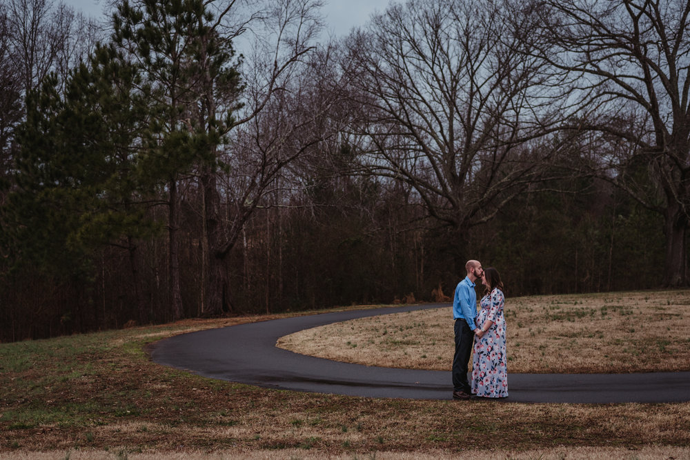 The parents to be pray for each other, picture taken by Rose Trail Images at Joyner Park in Wake Forest, NC.