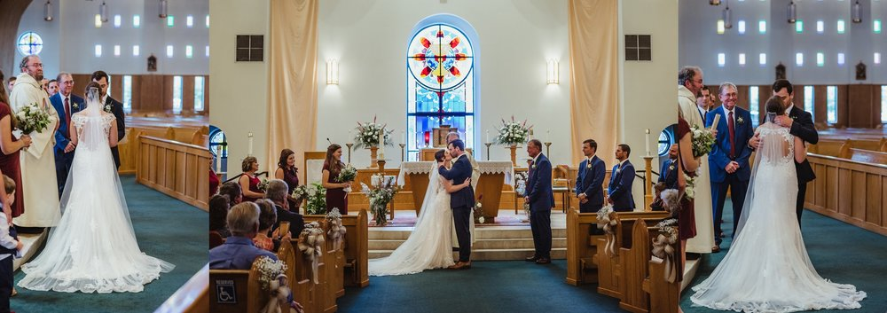 The bride and groom have a first kiss as husband and wife at their wedding ceremony at Saint Bernadette's Catholic Church in Fuquay Varina, North Carolina. Photo by Rose Trail Images.