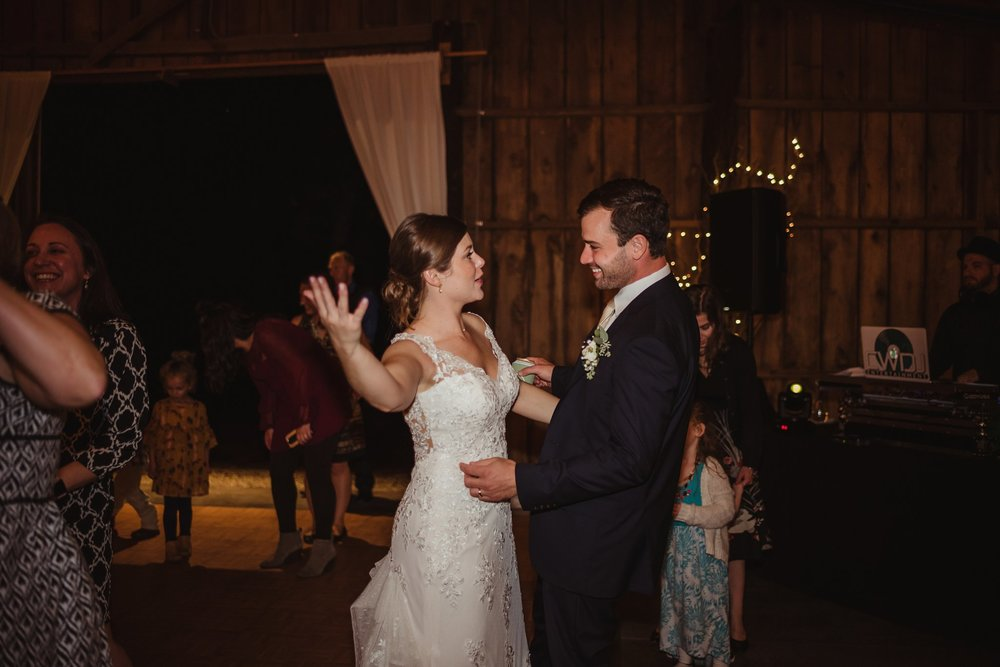 The bride and groom enjoyed dancing during their wedding reception at the Little Herb House in Raleigh, North Carolina. Photos by Rose Trail Images.