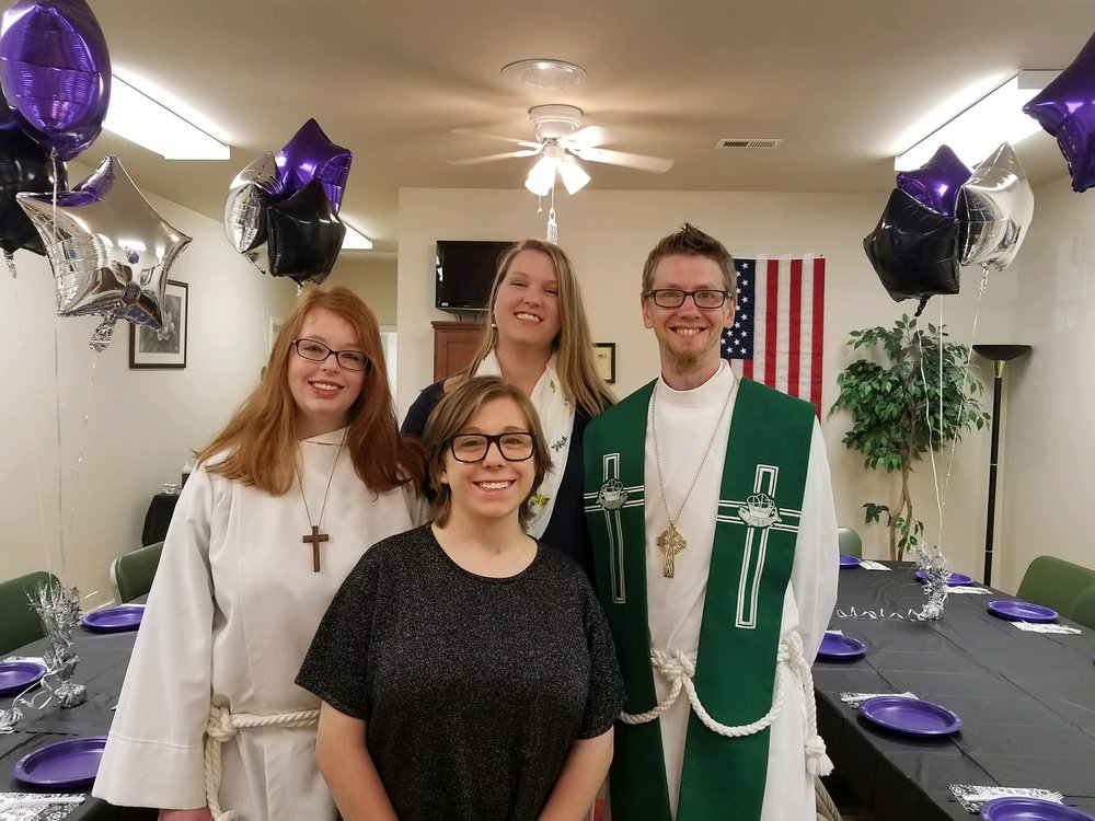 Fr. Jeremiah with the graduates just before church