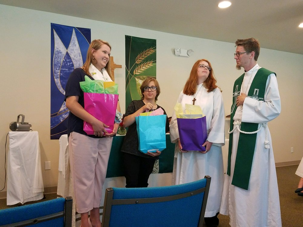 Fr Jeremiah presenting the graduates with their gifts