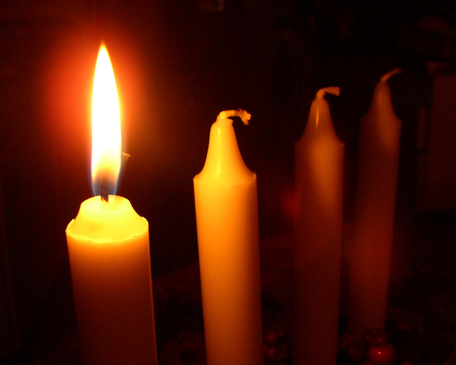 9550-close-up-of-a-first-lit-advent-candel-pv.jpg