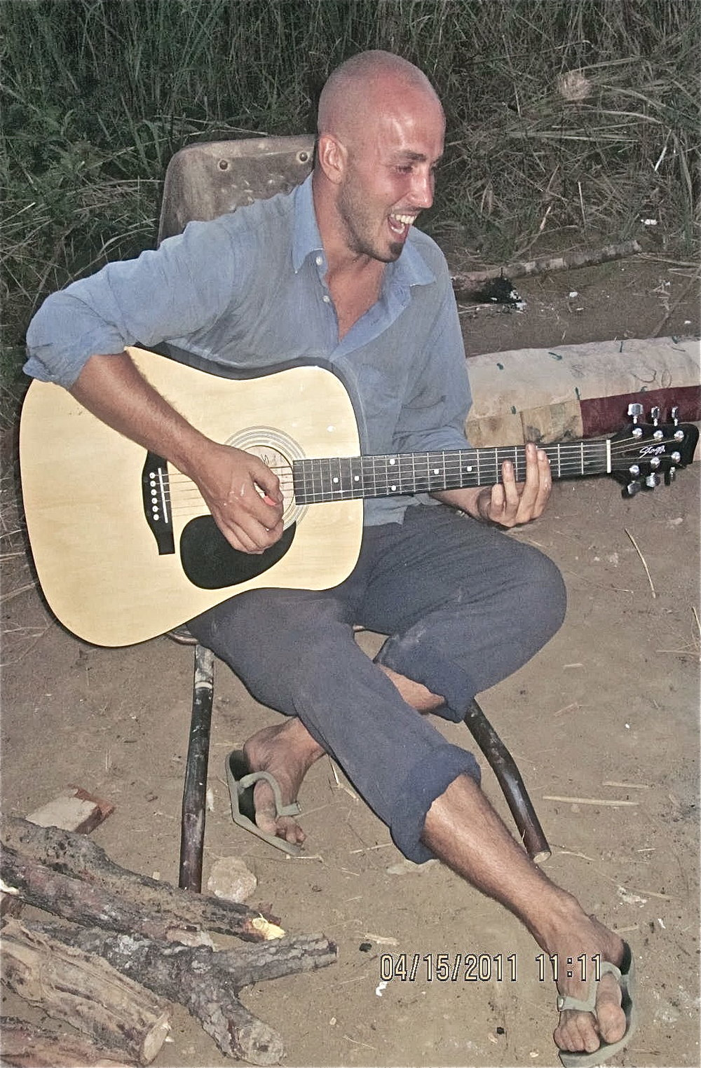 Sitting in a wheelbarrow and rocking songs in Kibombemene, Zambia in 2011 - Photo by Marissa Izma?