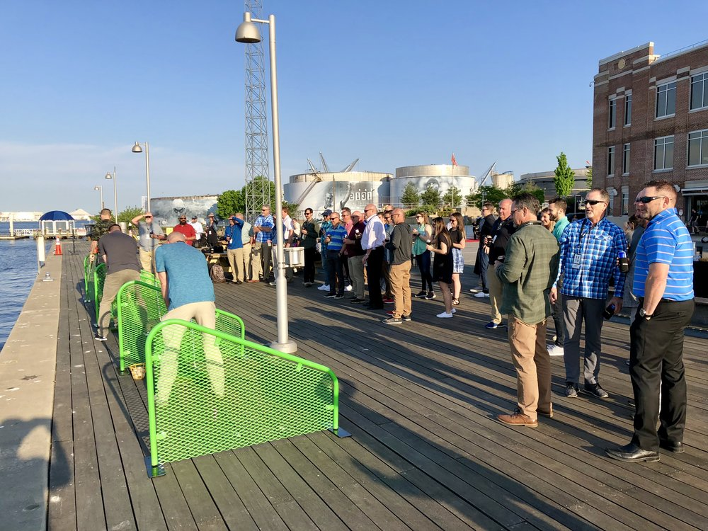 The crowd at Under Armour sure enjoyed watching us chase a floating golf target with in a Baltimore Water Taxi.