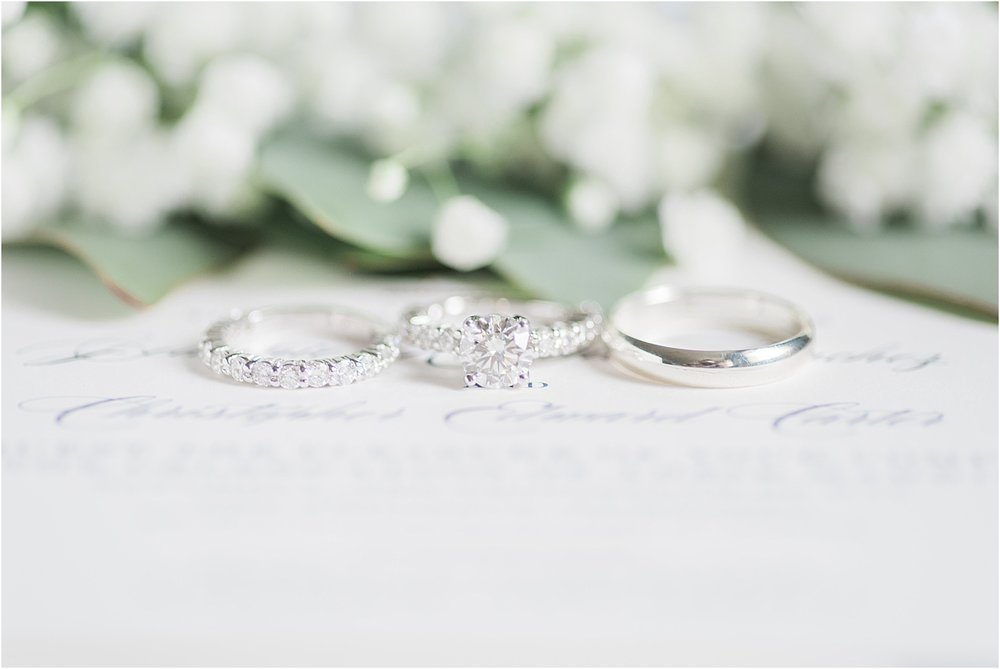 diamond wedding rings and bouquet