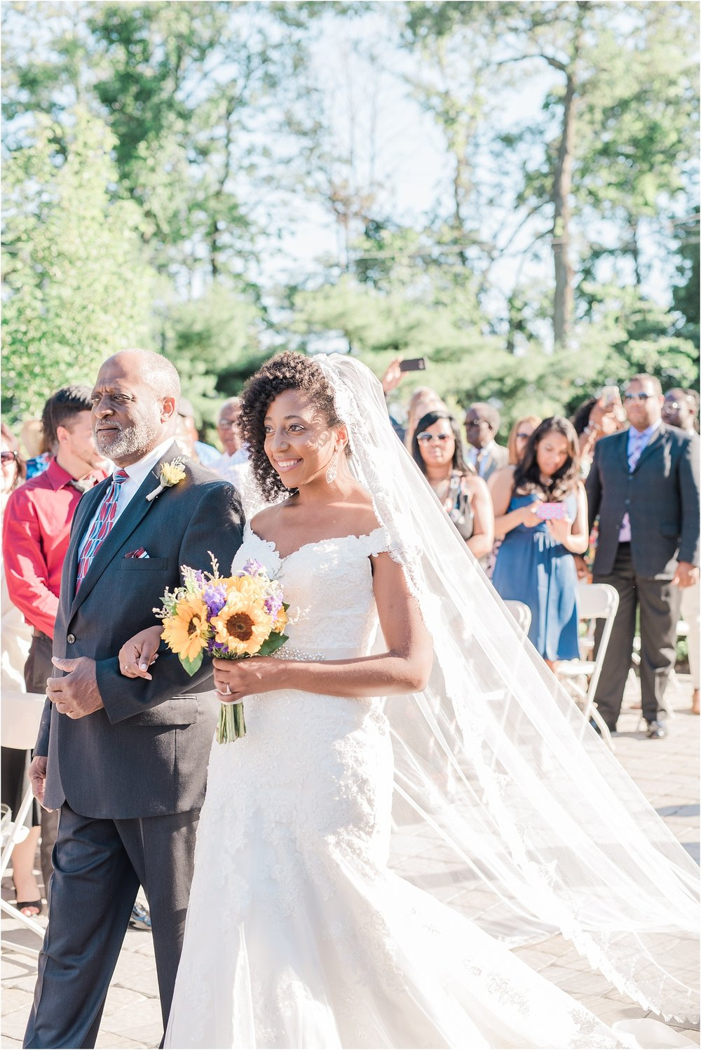 bride walking down the aisle with her father.jpg