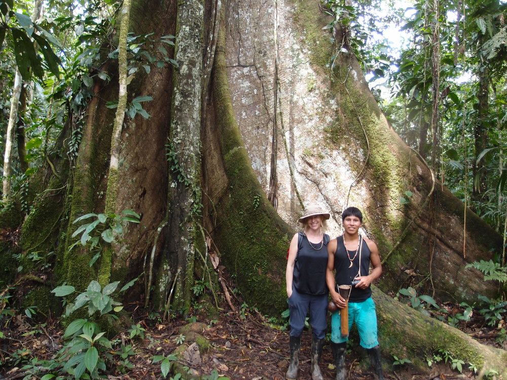 In front of a glorious ceiba tree with my amazing Huaorani  guide, Pegonka in the Ecuadorian Amazon rain forest.