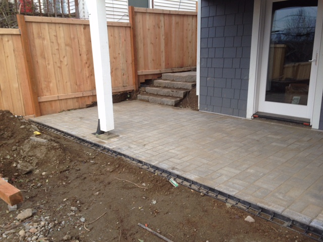 Pavers are laid and filled with sand