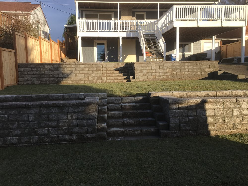 Terraced retaining wall, stairs and new sod