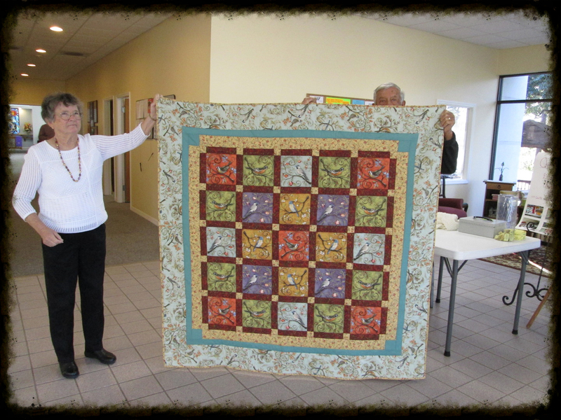 Nita and Bill Whyte display the quilt raffled off in March