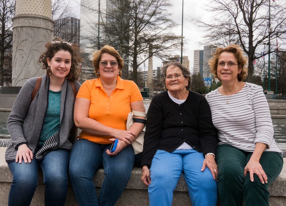 Daniella, Tia Flor, Mama, and Mommy sitting at Centennial Olympic Park!