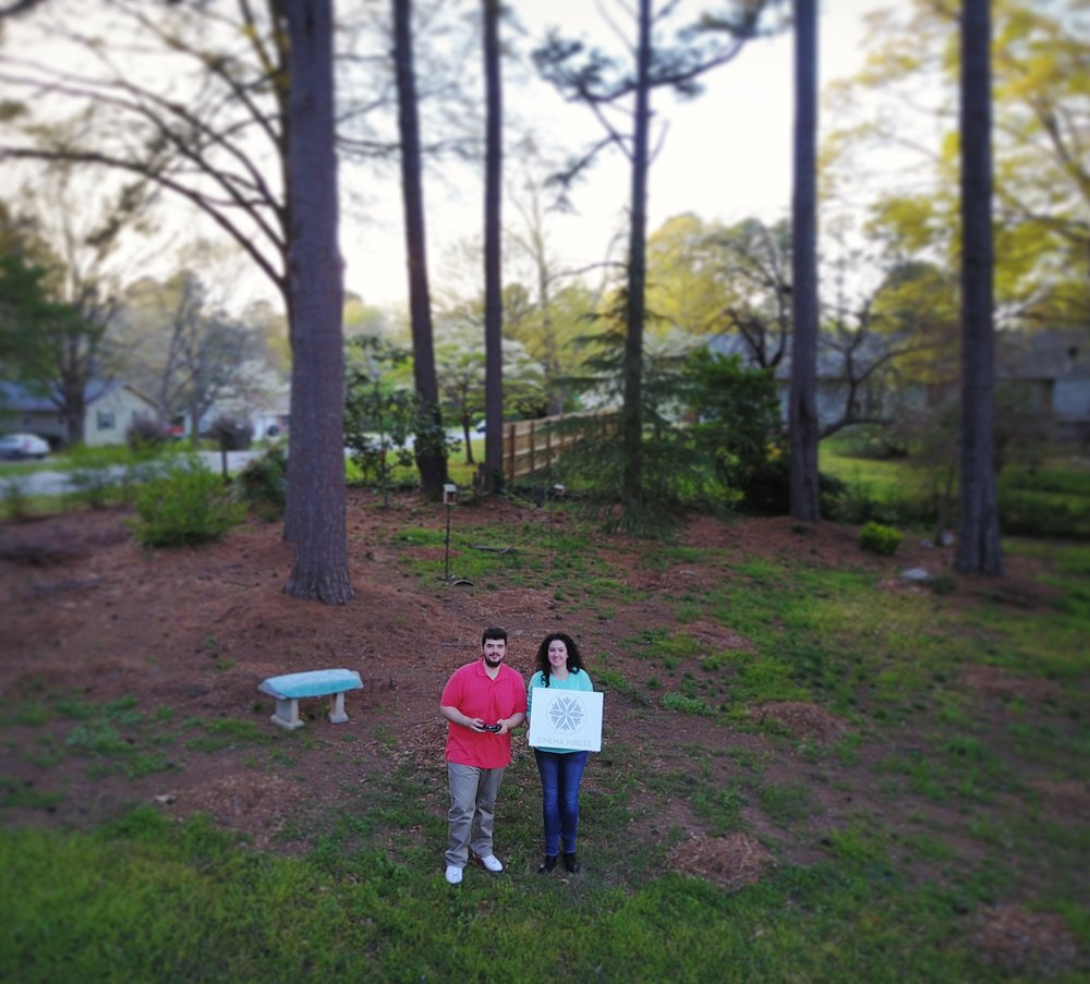 Backyard drone selfie with our logo canvas!