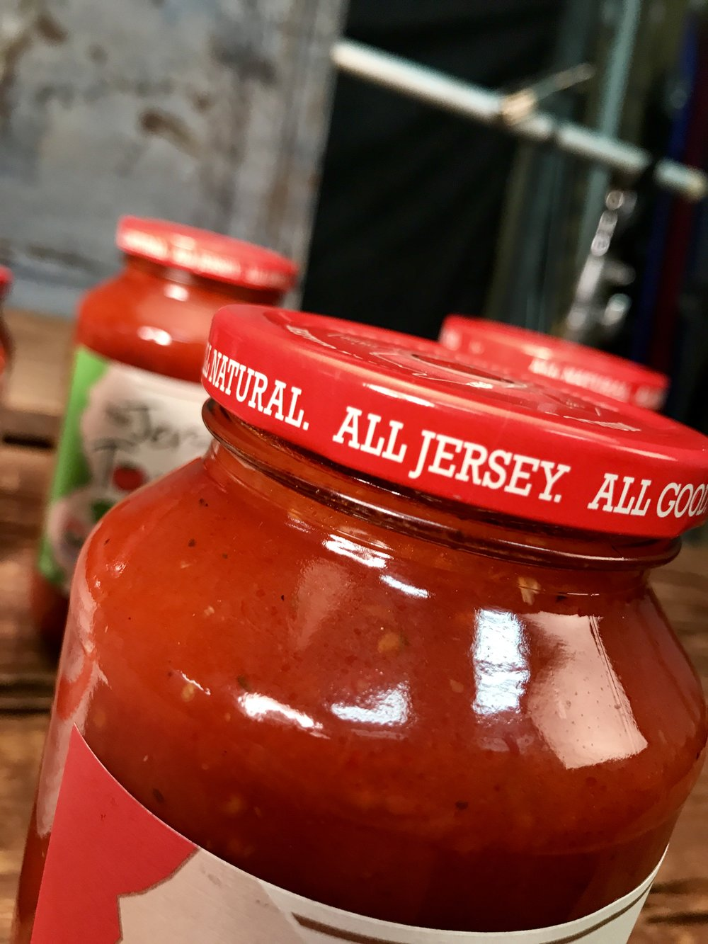 "All-new Ferarri red lids proclaim, ""All. Natural. All Jersey. All Good."""