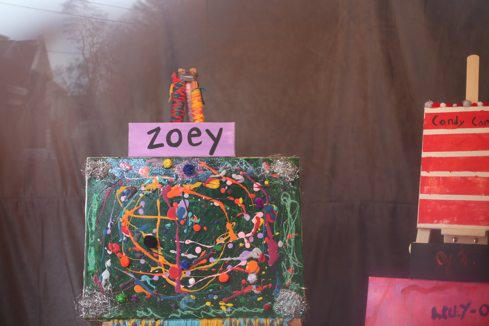 A bouquet of colorful and glittery mixed-media works by mother/ daughter duo, Jess and Zoey.