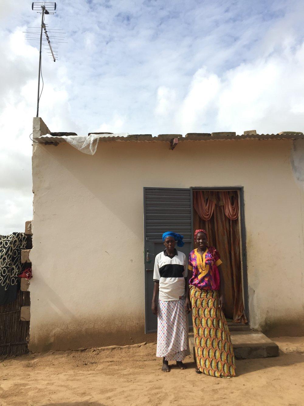 Senegal ladies in front of house w power.jpg