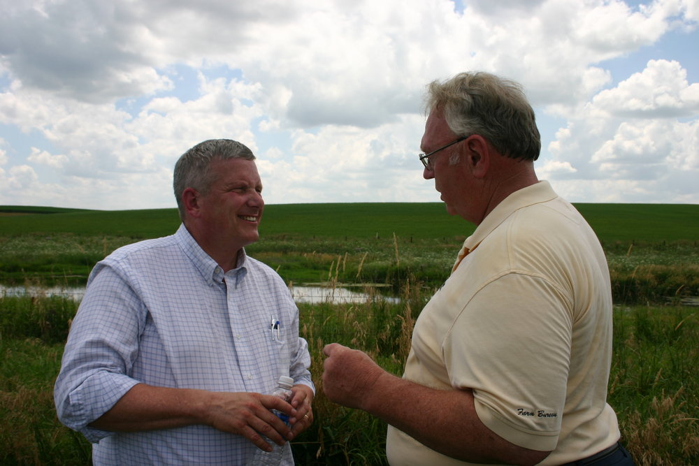 Iowa Secretary of Agriculture Bill Northey (left) says water quality initiatives in the state are driven by farmers like Doug Gronau who want to reduce environmental impact of their operations.