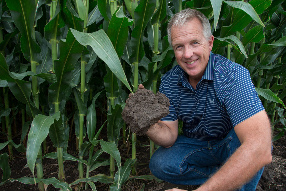 Steve Berger checking out the soil on his Wellman, Iowa farm