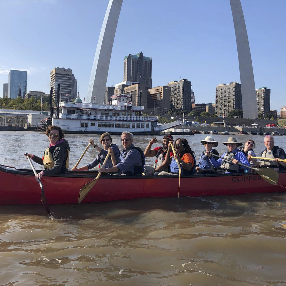 """STL Riverfront Adventure - What better way to experience the Great River City than from the river! This is the great St.Louis adventure. It includes a classic paddling trip in a professionally guided voyageur canoe, a chance to explore nature on a pristine Mississippi River island, as well as experience some unique and incredible views of the downtown riverfront. We meet right in front of the Arch, and shuttle to our put in upstream on the Mighty Mississippi. Our expert guides will provide you with everything you need and help you board one of our extraordinary 29 foot voyageur canoes. Our route takes us into the only non-navigational reach of the River to an island to enjoy lunch. There is plenty of time to explore the island before we continue our journey into the Port of St.Louis. We pass beneath five awesome, contemporary and famous historic bridges, with incredible views of some of St. Louis's oldest riverfront buildings. The final destination lands you right in front of the Gateway Arch on the historic landing of downtown St. Louis. This is a wonderful """"only in St.Louis"""" experience you will love!· How Often? – Monday and Friday starting in May· Best for? - Everybody! (over 5 with parent)· How long? - 3 - 4 hours· What is included? – Gear, canoes, guides, lunch and shuttle· Price? $60"""