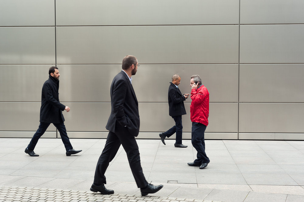 red-man-amongst-city-workers.jpg