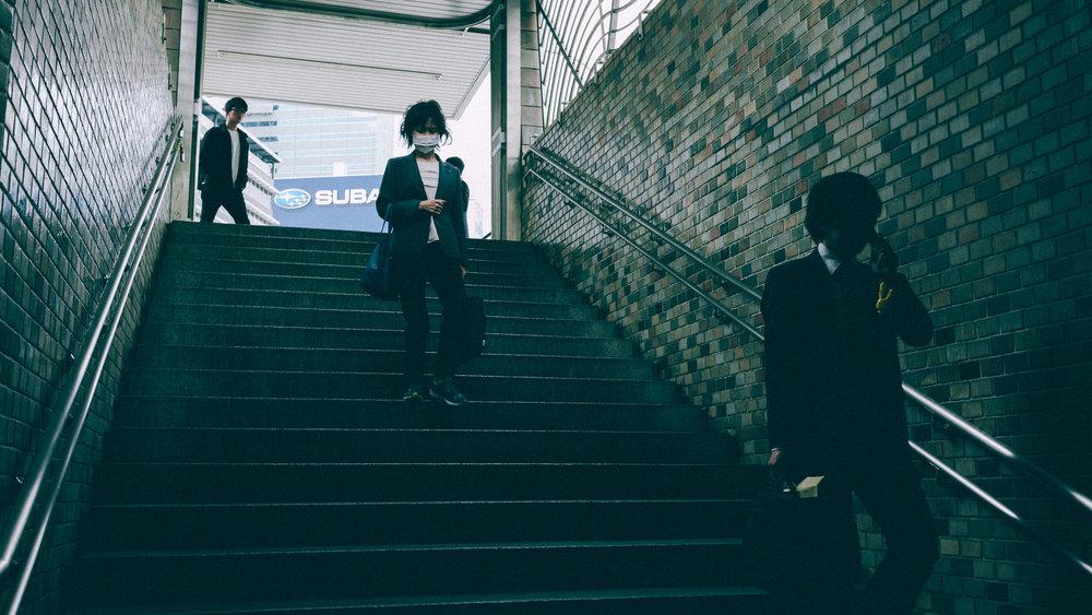people-walking-down-tokyo-metro.jpg