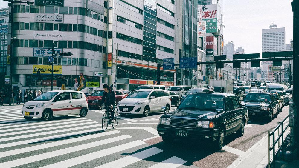 street-bikes-taxis-tokyo-crossing.jpg
