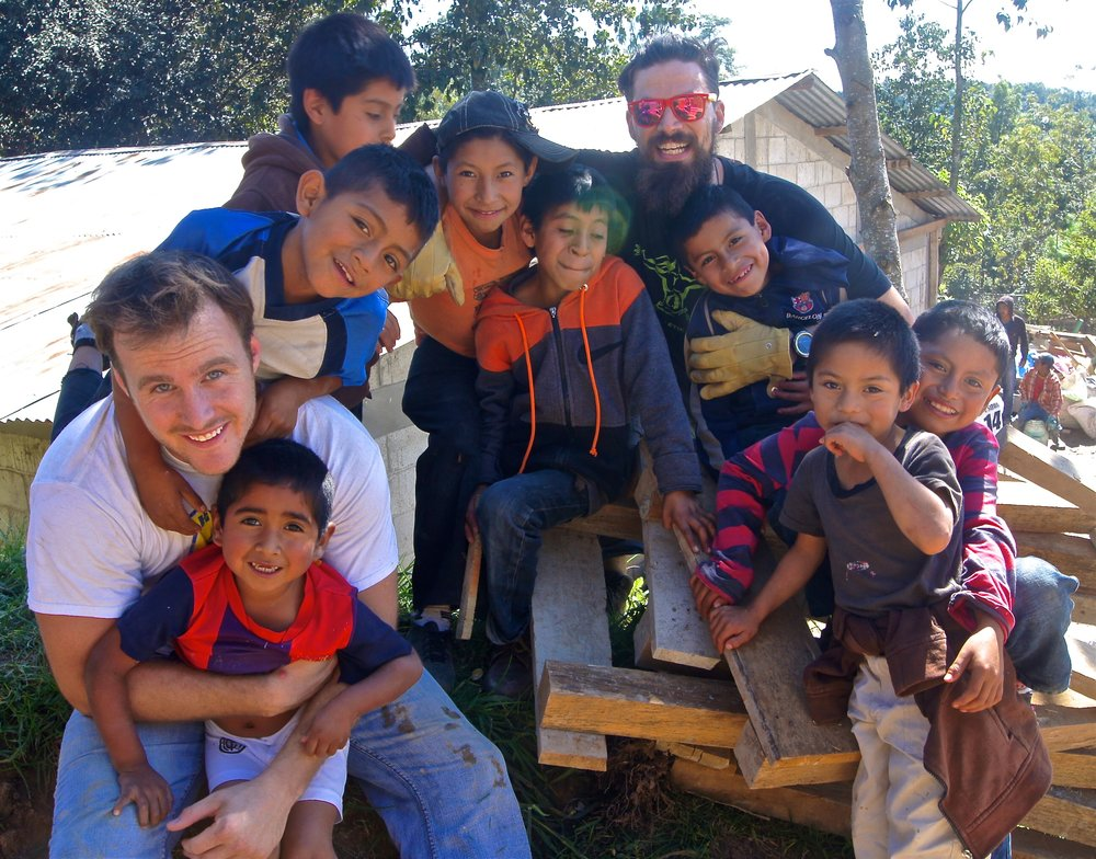 Anthony wrestling with a group of boys in  Sacala, Guatemala