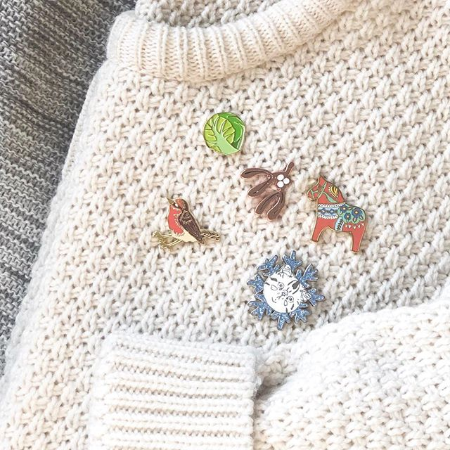 Is it acceptable to wear Christmas pins now it's December? 🎄This grinch needs some persuading to feel festive, so popped all my festive pins on a cosy jumper ✨  Sprout pin - @chimpsteaparty, Mistletoe pin - @anniedornansmith, ❄️ Cat - Hello Harriet @halfheartedclub and our Robin & Dala pins ⛄️