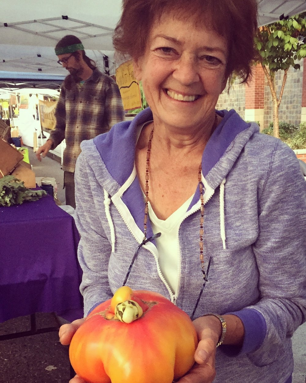 one of our amazing volunteers, Carol, and her giant tomato