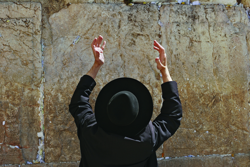Praying man at Wailing Wall_6175117.jpg