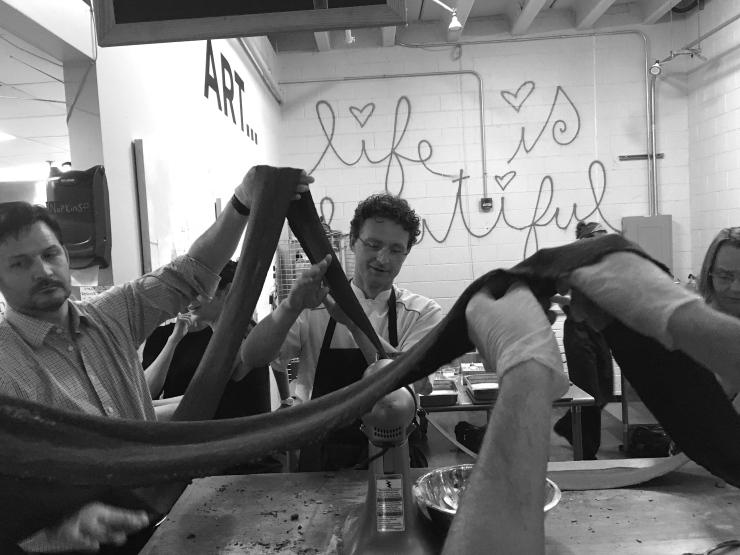 Cooking class participants making pasta at Al Volo.