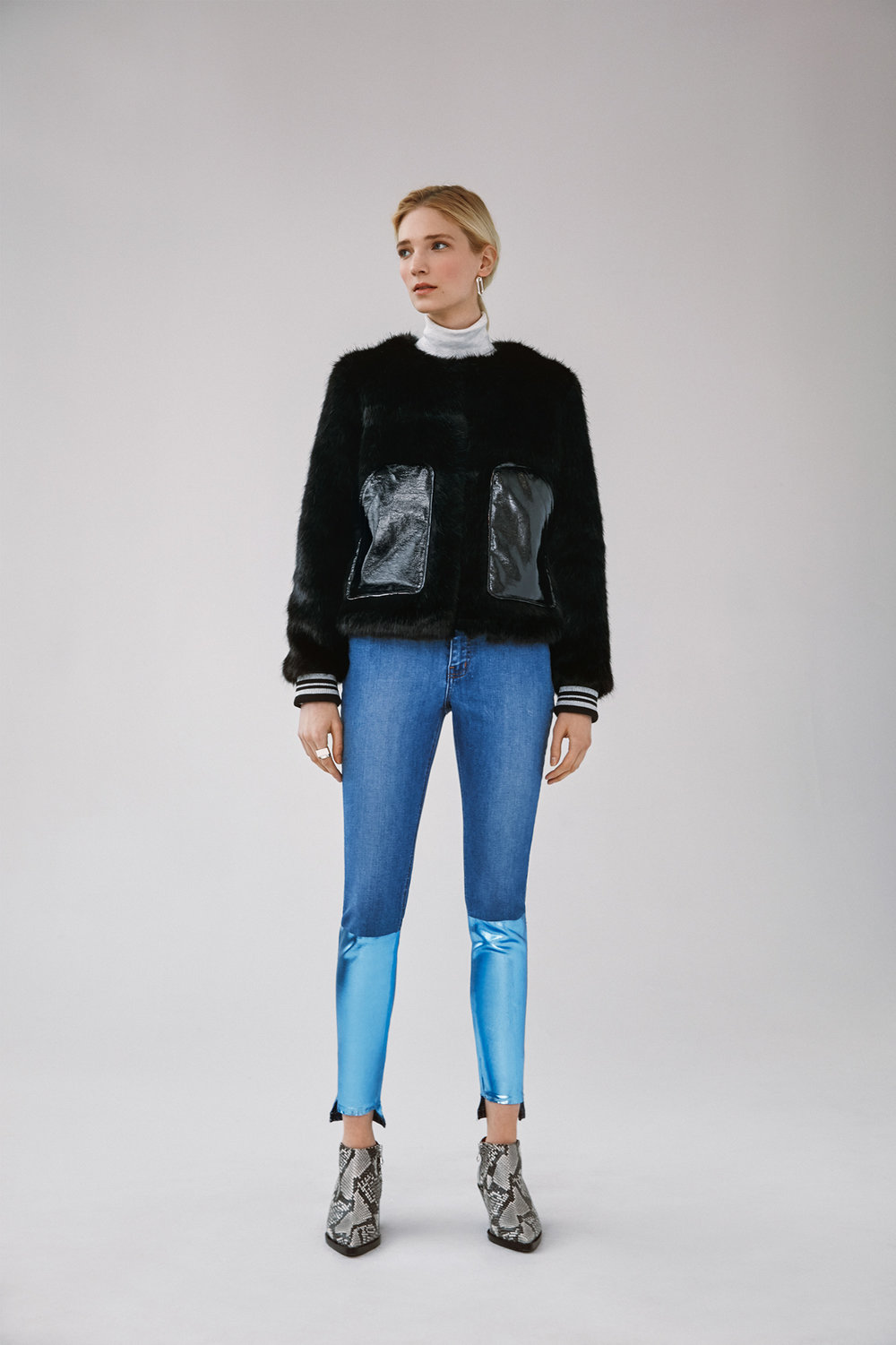faux fur jacket with contrast pocket high waist foil block printed uneven hem skinny jeans