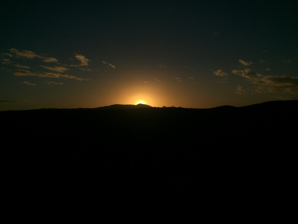 Sun setting over the desert hills