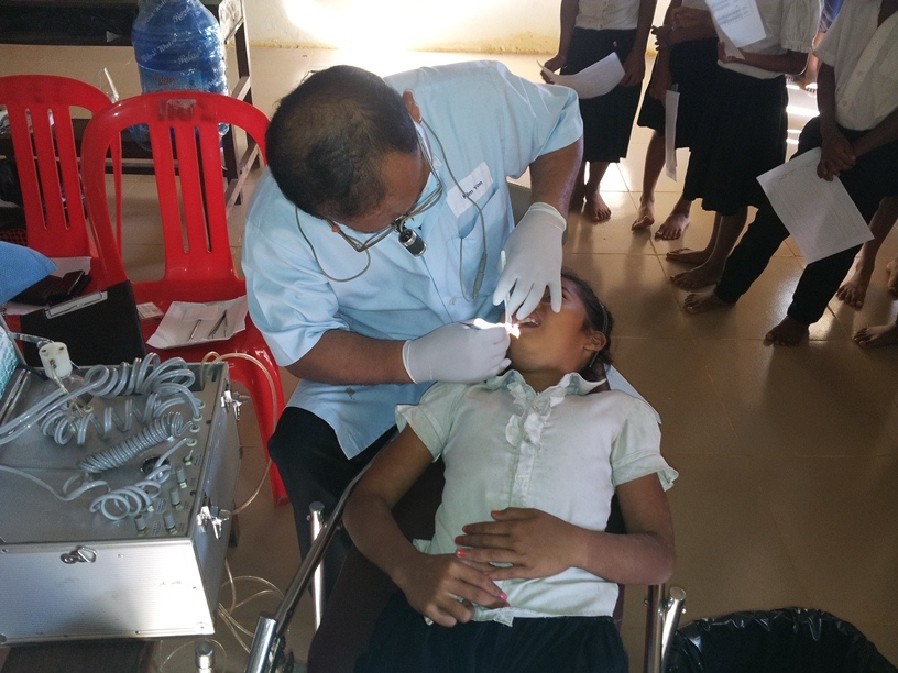 A girl student's dental exam